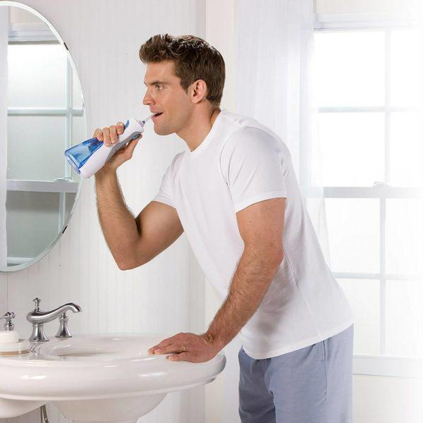 Man using the WP-450 Cordless Plus water flosser